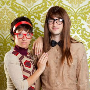 13123628-Funny-humor-silly-nerd-couple-on-retro-vintage-wallpaper-background-Stock-Photo