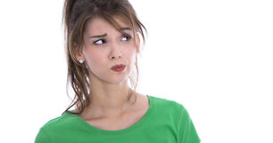 face-skeptical-young-woman-green-shirt-isolated-over-white-40538166