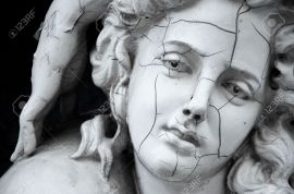 11479263-Cracked-face-of-female-Greek-sculpture-Stock-Photo-statue